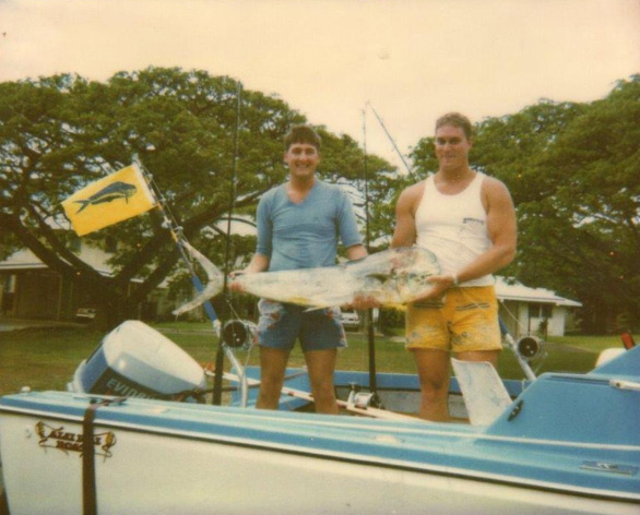 Greg Foster and Roy Sokolowski (Fish is a Mahi Mahi) on Roy's 17-foot boat. Courtesy of Roy Sokolowski