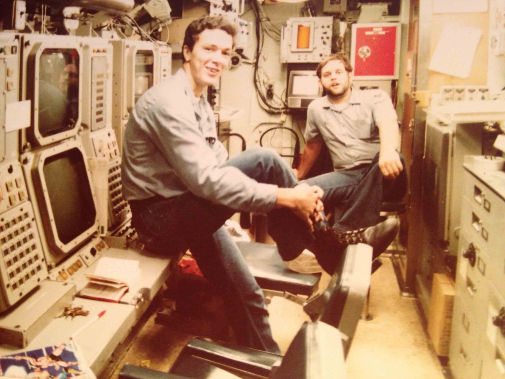 The sonar control room on Bremerton around 1983. Sonar Technician's William D'Happart and Jeff Marcey enjoying a rare photo opportunity inport  between working on the gear. - photo by Challen Yee